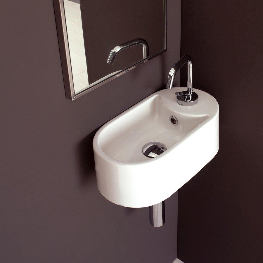Curvet   lille håndvask i flot design til det lille bad.